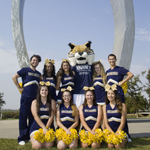 Tour guides with Rufus the Bobcat